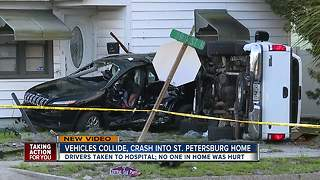 One injured when two vehicles collide, crashing into house in St. Pete - Video