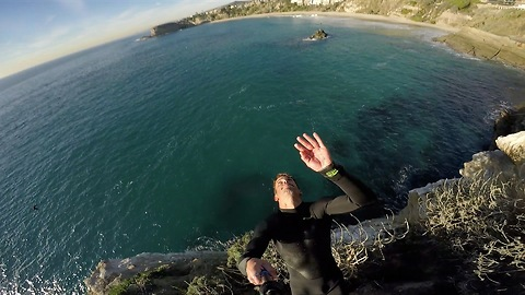 Guy pulls off epic back flip off cliff with GoPro in hand