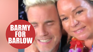 Gary Barlow picks female fan to join him on stage during gig - Video