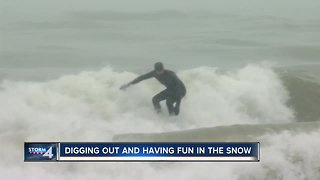 Locals ride waves at Bradford Beach during snowstorm