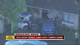 Collision sends cars into Tampa home - Video