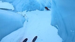 STUNNING MOMENT SKIERS RACE THROUGH FROZEN CANYON