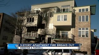 Three-story apartment fire breaks out
