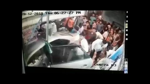 Moment out-of control car rams into crowded shop in India, injuring 3