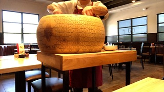 Arizona restaurant makes some of its pasta in a 50-pound cheese wheel