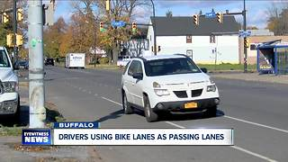 Stay in your lane! Neighborhood warns drivers to share road with bikes - Video