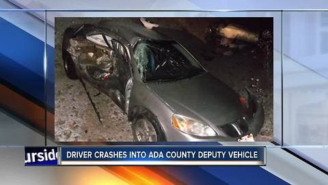 Driver crashes in deputy vehicle