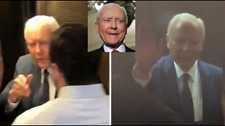 Orrin Hatch waves off unhinged leftist protesters at elevator