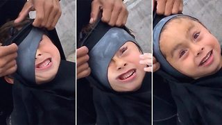 Wetsuit fail for surfing five year old - Video