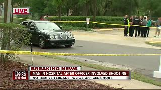 Man in hospital after officer-involved shooting - Video