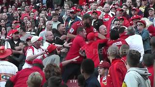 Fans throw punches in the stands during rugby match