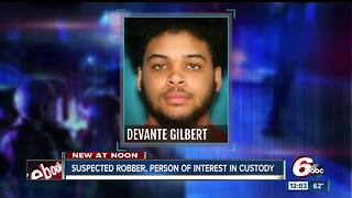 Suspected robber, person of interest in triple homicide in custody - Video