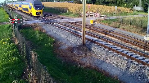 Cyclist escapes death on unguarded train level crossing
