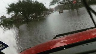 Heavy Rains Flood Residential Streets in Texas - Video
