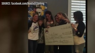 1 October survivors receive checks from non-profit - Video
