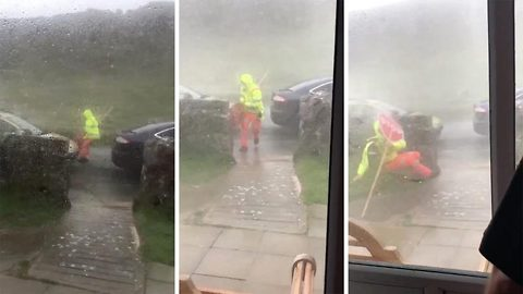Shocking moment traffic woman is blown over by strong wind during storm Ali