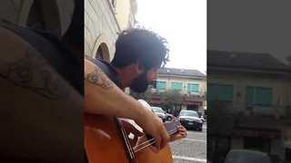 Man Stuck With Two Stringed Guitar Creates Original Composition - Video