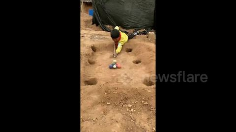 Chinese village boy makes pool table out of clay