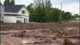 River of Floodwater Destroys Roads and Property in Ripley, Michigan - Video
