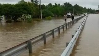 River Overflows Onto Road as Tropical Storm Nate Hits Panama