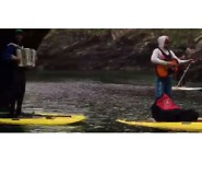 Watch These Musicians Busk on Their Paddleboards and Perform Inside a Cave - Video