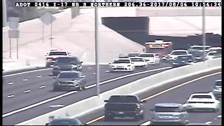 Man hurt after jumping out of moving car on Interstate 17 - Video