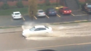 Cars Drive Through Flooded Streets in Boone, North Carolina - Video