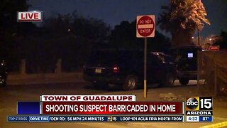 Shooting suspect barricaded in home
