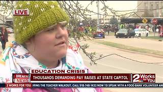 Thousands rally at state capitol to demand pay raise