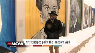 Local artist helped paint the Freedom Wall - Video