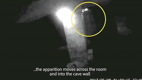 Ghoul 'carrying lantern' walks through cave wall – interrupting ghost hunter's hols