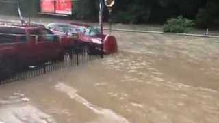 Man Jumps From Car Roof to Escape Severe Pittsburgh Flooding - Video