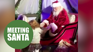 A little girl took her first steps unaided - to see Santa in his grotto - Video