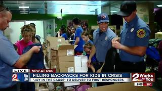 Filling backpacks for kids in crisis - Video
