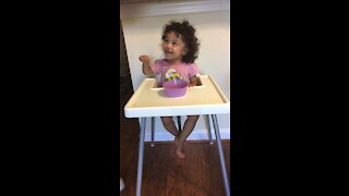 Well behaved toddler is asked not to eat while her mom leaves the room