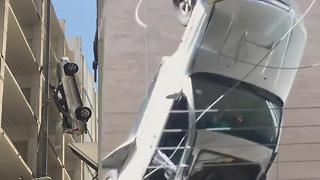 Man Narrowly Saved From Dangling Car