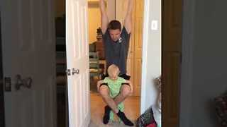 Daredevil Daughter Hangs on As Dad Does Pull Ups - Video