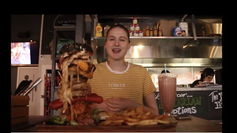 Beauty and the Beast: Model Beats Monster Burger Challenge