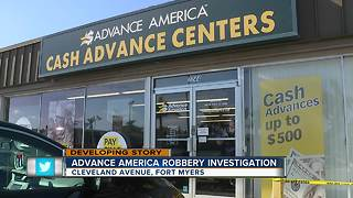 Check-cashing business robbed - Video