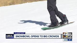 Snowbowl opens despite lack of natural snow - Video