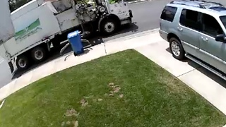 Waste collector steals trash can from family's lawn - Video