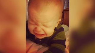 Sweet Baby Disapproves of Dad's Singing - Video