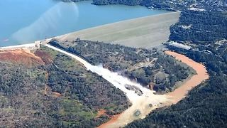 Aerial Video Shows Water Rushing Down Oroville Dam Spillway - Video