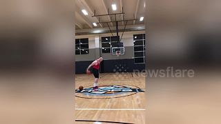 Man performs impressive basketball trick shots - Video
