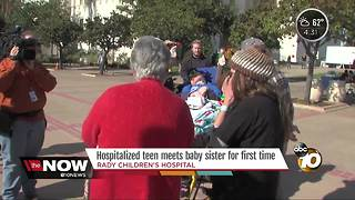 Hospitalized teen meets baby sister for first time - Video