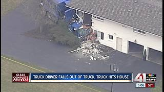 Garbage truck crashes into house in Prairie Village - Video
