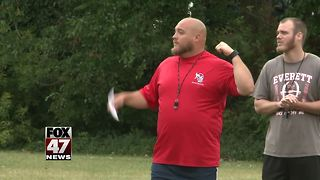 Everett High School football coach placed on leave - Video