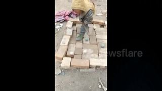 Chinese village children play pool on table made of bricks - Video