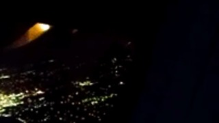Passenger Records Flames Shooting From Plane Wing - Video