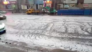 Hail storm brings flooding to central China - Video